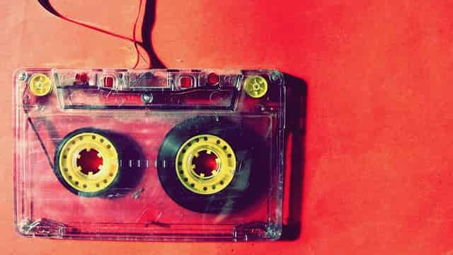 Red Cassette hanging in front of a red background