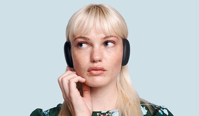 A girl wearing Human Headphones